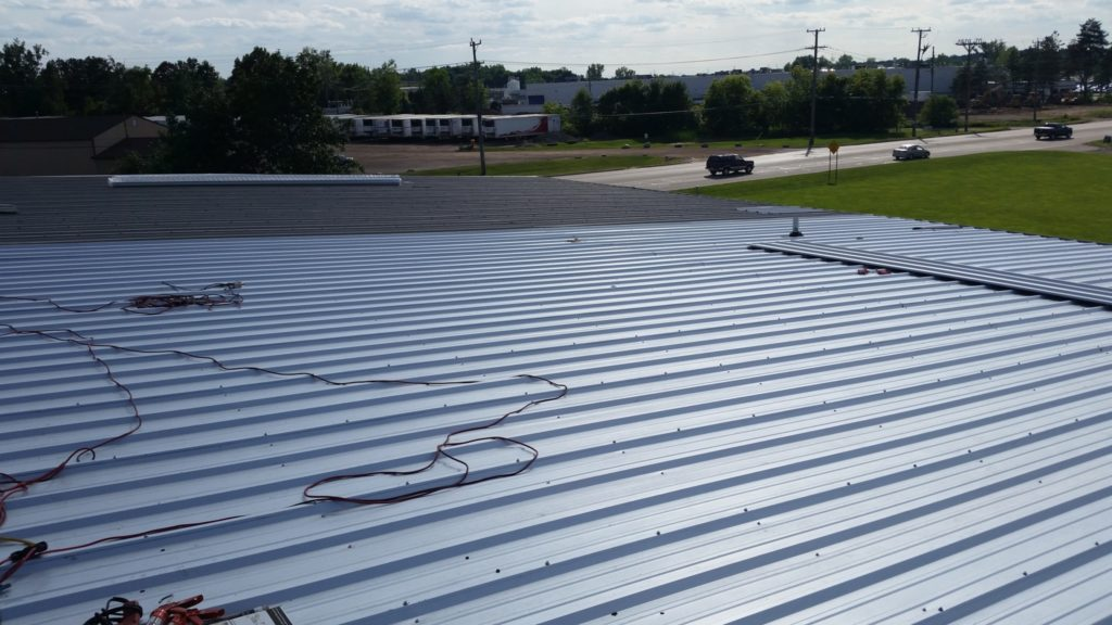 Steel building repairs, steel building roof repair, steel building retrofit